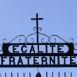 Egalite' fraternite' and cross sign - Stock Photo