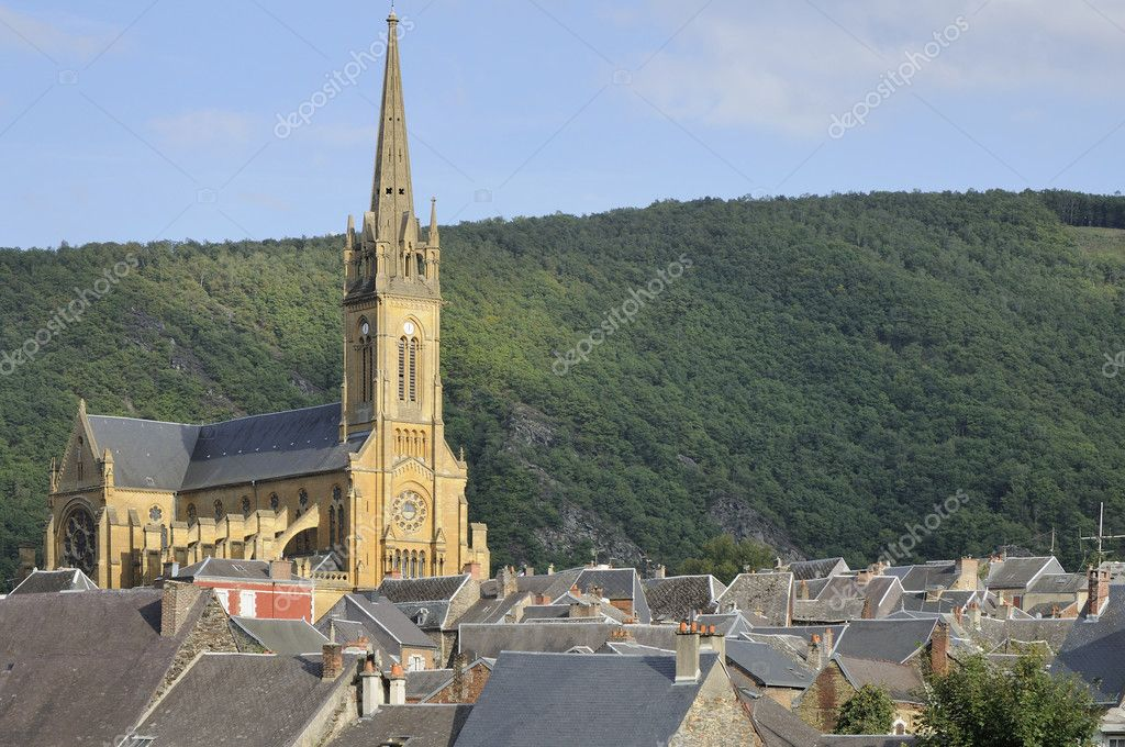 Foreshortening of  big church over village slate roofs, shot in bright summer light  Stock Photo #6940956