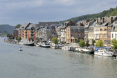 Houses and boats on meuse, dinant — Stock Photo