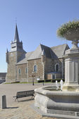 Fountain and church, signy le petit, ardennes — Stock Photo