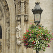 Flowering lamp post in grand place — Stock Photo