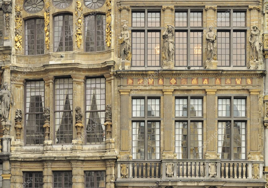 Detail of historical buildings classic facades with golden baroque decoration prospecting on famous square in city center  Stock Photo #7174003