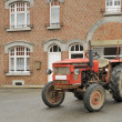 Old tractor and house, ardennes - Stock Photo