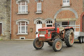 Old tractor and house, ardennes — Stock Photo