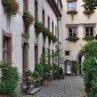 Stock Photo: Bishofhof courtyard with flowers, regensburg
