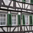 Green shutters on wattle facade, tubingen — Stock Photo