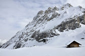 Hut at collac peak in winter, dolomites — Stock Photo