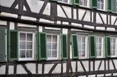 Green shutters on wattle facade, tubingen — Stock Photo
