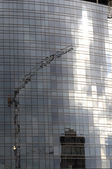 Reflections of crane at building site, milan — Stock Photo