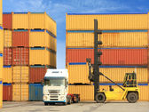 Forklift and truck with shipping containers — Stock Photo