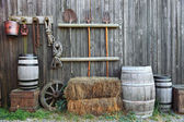 Barrel bale and fork in old barn — Stockfoto