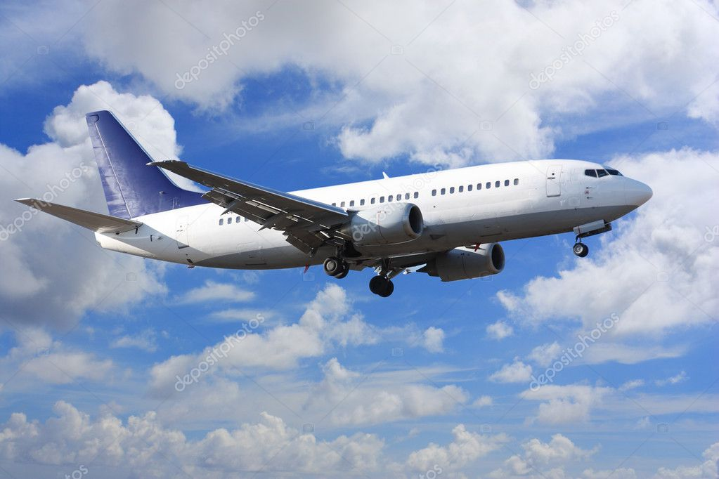 Jet airplane landing in bright cloudy sky — Stock Photo #6827002