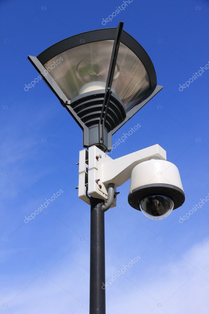 Security camera on street lamp over blue sky  Stock Photo #6827542