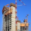 Stock Photo: Tower building under construction with crane