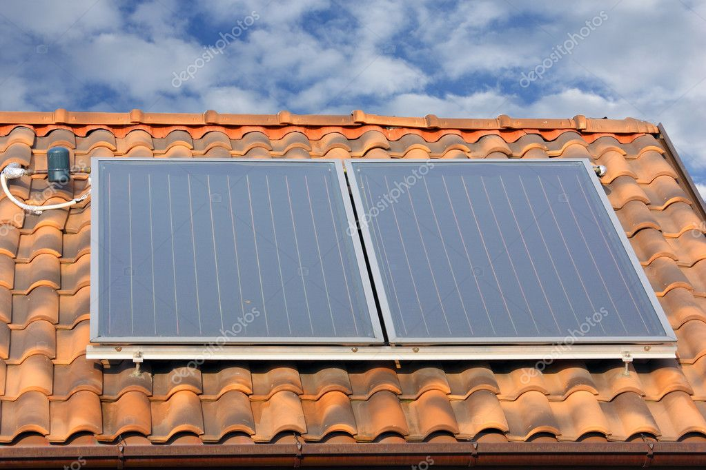 Solar panel on a roof. hot water production — Stock Photo #6867716
