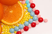 The different color vitamins with orange DOF — Stock Photo