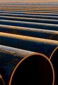 Pipes laid in a row — Stock Photo