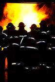 Fireman fighting fire — Stock Photo