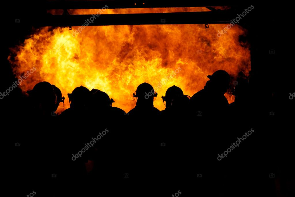 Firemen walking in the fire — Stock Photo #6827640