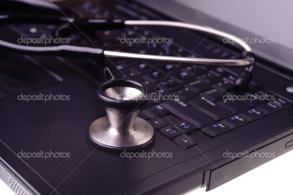 Stethoscope resting on laptop — Stock fotografie #6828019