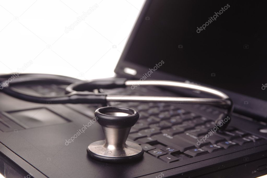 Stethoscope resting on laptop — Stock Photo #6828023