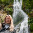 Stock Photo: Smiling woman at waterfall