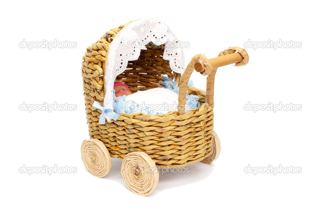 Paper stroller with a toy or as decoration for your home, office, trade, etc. On a white background. — Stock Photo #7176927
