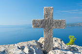 Cross on top of the mountain above sea level — Stock Photo