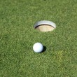 Golf ball on a green - Stock fotografie