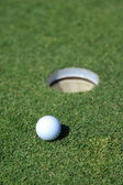 Golf ball on a green — Stock Photo