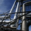 Low-angle shot of ladder and tanks refinery — Stock Photo