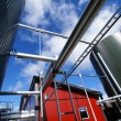 Industrial piping and tanks against blue sky — Foto de Stock