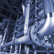 Stockfoto: Pipes, tubes, machinery and steam turbine at power plant