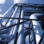 Industrial pipelines on pipe-bridge in blue tone — Stock Photo #6923782