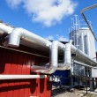 Stock Photo: Industrial zone, Steel pipelines against blue sky