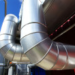 Stock Photo: Industrial zone, Steel pipelines in blue sky