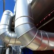 Industrial zone, Steel pipelines in blue sky — Stock Photo