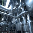 Pipes, tubes, machinery and steam turbine at a power plant — Stock Photo #6929412