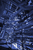 Pipes, tubes, machinery and steam turbine at a power plant — Fotografia Stock