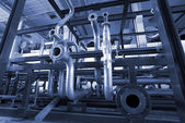 Different size and shaped pipes at a power plant — Stock Photo