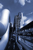 Industrial pipelines on pipe-bridge in blue tone — Stock Photo