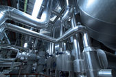 Pipes, tubes, machinery and steam turbine at a power plant — Stockfoto