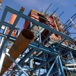 Cranes and beams on construction of industrial factory — Stock Photo #6930510