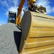 Excavator against blue sky — Stock Photo