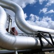 Industrial zone, Steel pipelines on blue sky — Stock Photo