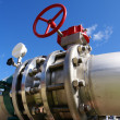 Industrial zone, Steel pipelines and valve on blue sky - Stock Photo