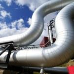 Industrial pipelines on pipe-bridge against blue sky — Stock Photo #6930590