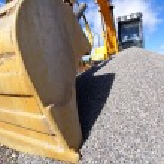 Excavator against blue sky — Stock Photo #6931225