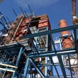 Cranes and beams on construction of industrial factory — Stock Photo #6931252