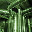 Ventilation pipes of an air condition in green tones — Stock Photo
